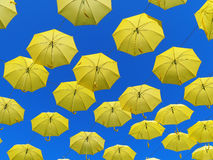 Yellow umbrellas in the air clear sky Royalty Free Stock Photos