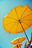 Yellow umbrellas on the beach royalty free stock photography