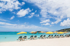 Yellow Umbrellas Over Green Chairs Under Blue Sky Stock Photography