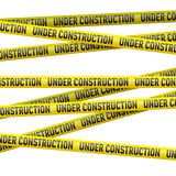 Yellow under construction danger tape Stock Images