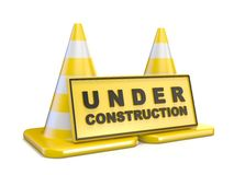Yellow UNDER CONSTRUCTION sign and two road cones Royalty Free Stock Photography