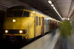 Yellow underground train Stock Images