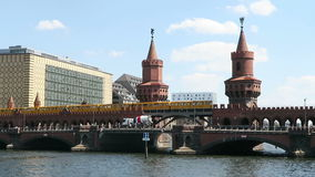 Yellow underground train passing by the Oberbaumbruecke at top of bridge. stock video footage