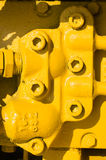 Yellow unit with bolt heads Stock Photo