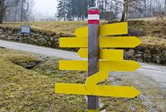 Yellow unlabeled signposts Royalty Free Stock Photo