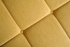 Yellow upholstery. Close up image of yellow upholstery Royalty Free Stock Photos