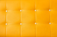 Yellow upholstery leather background Stock Images