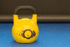 Yellow used and old kettlebell. Workout equipment Royalty Free Stock Image