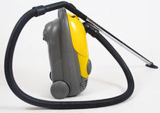 Yellow vacuum cleaner Stock Images