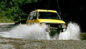 Yellow Van. Yellow 4x4 van crossing creek in California Stock Images