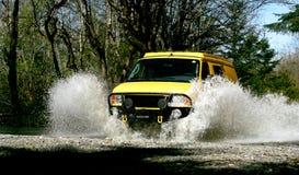 Yellow Van. Yellow 4x4 van crossing creek in California Royalty Free Stock Image
