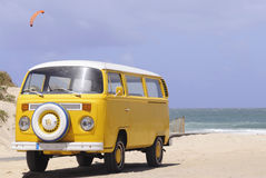 Yellow Classic Bus_Sand Beach_Vintage Transportation Stock Photography