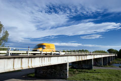 Yellow Van on Bridge. Yellow van speeds across bridge over river Stock Photos