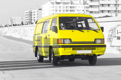 Yellow van - selective color isolation. Yellow van in Porto, Portugal Stock Photography
