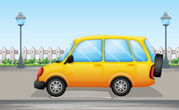 A yellow van in the street Royalty Free Stock Photo
