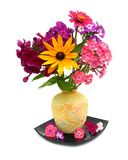 Yellow vase. Beautiful flowers in a yellow vase on a white background Royalty Free Stock Photos