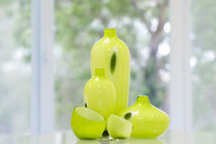 Yellow vases. Five yellow vases on a background of a window in a garden Stock Images