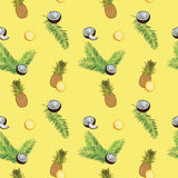 Yellow vector seamless  pattern. Pineapple, coconut, palm leaves. Royalty Free Stock Image