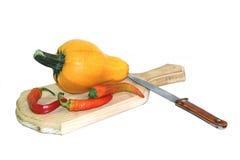 Yellow vegetable marrow. Vegetable marrow lays on a finishing kitchen board Stock Photos