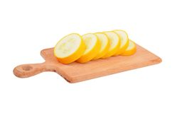 Yellow vegetable marrow (zucchini). On wooden board, isolated on white background Stock Photo