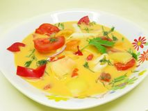Yellow vegetable soup with tomato and pasta Royalty Free Stock Photos