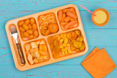 Yellow vegetables and fruit in tray Stock Photo