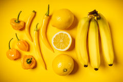 Yellow vegetables and fruits on background. Fresh vegetables and juicy fruit on a yellow background Stock Image