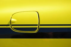 Yellow vehicle fuel filler cap Royalty Free Stock Images