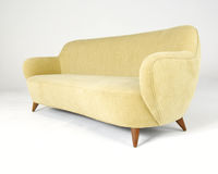 Yellow velour modern style sofa Royalty Free Stock Photo