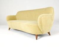 Yellow velour modern style sofa Royalty Free Stock Photo