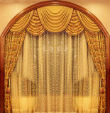 Yellow velvet theater curtains. In a hotel Royalty Free Stock Photography