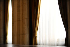 Yellow velvet window curtain Stock Images