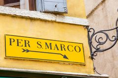 Yellow Venice sign to San Marco square in Italy. Travel and Tourism concept. Yellow Venice sign to San Marco square in Italy. Travel and Tourism concept Royalty Free Stock Photos