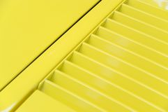 Yellow vent. A background of a yellow vent on a classic car stock image
