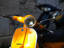 Yellow vespa Royalty Free Stock Image