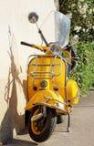 Yellow Vespa Stock Photo
