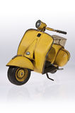 Yellow Vespa scooter front side Stock Photography