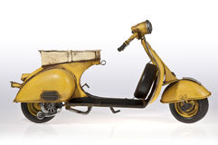 Yellow Vespa Scooter Lateral Royalty Free Stock Photo