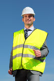 Yellow vest. Young man with hardhat and yellow vest Stock Images