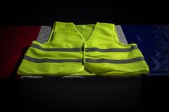 Yellow vest on French flag. Yellow vests protests  in France concept royalty free stock image