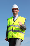 Yellow vest and hardhat. Young businessman with hardhat and yellow vest Stock Photos