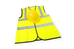 Yellow vest  and hardhat isolated. On the white Stock Photo
