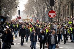 Yellow Vests. ActeXIX. Paris, France, March 23, 2019. Yellow Vest protests stands in Paris against French President Emmanuel Macron's economic policies in royalty free stock photo