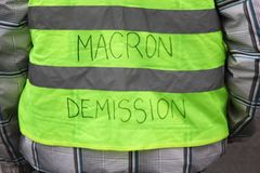 Yellow vests protest against higher fuel prices and ask president Macron departure. In France royalty free stock photography