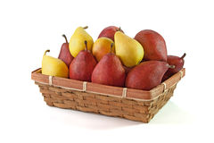 Yellow and vinous pears in the basket  on white Royalty Free Stock Image