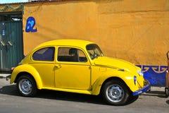 Yellow Vintage Beetle Volkswagen. Yellow vintage VW Beetle. Seen in Mexico Stock Photography