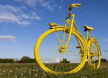 Old Yellow Bicycle in a Field Stock Images