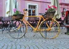 Yellow vintage bike in the street Stock Photo