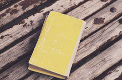 Yellow vintage book on wooden shabby background Royalty Free Stock Photography