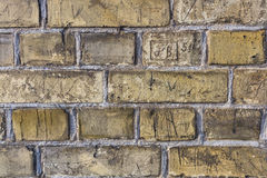 Yellow vintage brick wall texture. Background old urban city brick wall Royalty Free Stock Photo